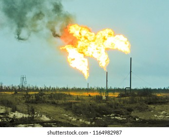 Two gas flares burning and smoking