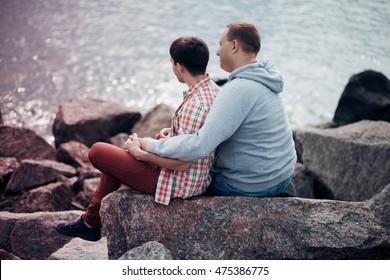 Two gay man looking at sea