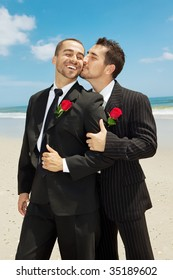 Two gay men at the beach after wedding.