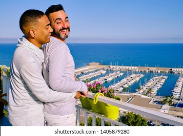 Two gay men in front of the bay on a summer day