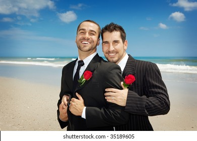 Two gay men looking into camera after a wedding ceremony