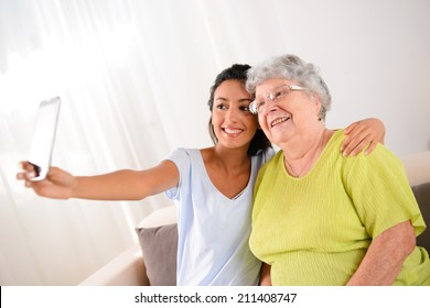 two generation multi-ethnic womans making a funny selfie together