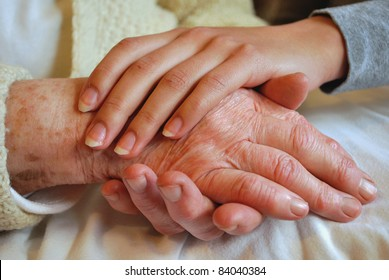 Two Generations embracing and Holding Hands - Grandmother Daughter