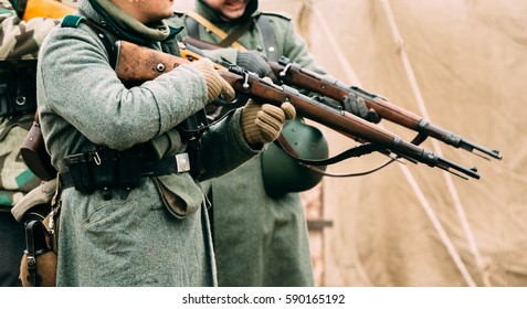 Two German soldier of the Second World War with Mauser rifles in their hands, ready to fire. Reconstruction