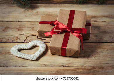 Two gift boxes tied with red ribbon and heart of handmade.
