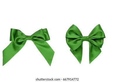 Two gift green satin bow with tails isolated on white