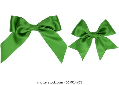Two gift green silk bow with tails on white background