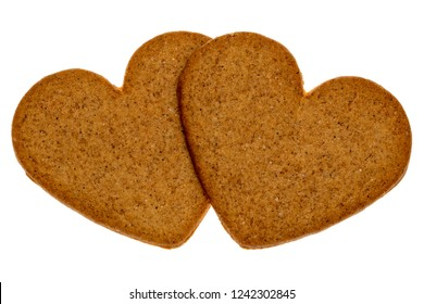 Two gingerbread cookies in a heart shape isolated on white background