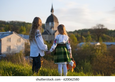 Two girl in national dress at traditional Easter celebration in West Ukraine