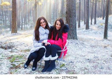 two girl playing in the winter forest