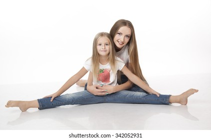 Two girl sitting on the floor