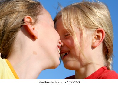 Two girl touching each other with noses