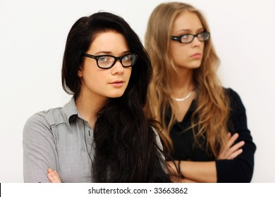 Two girlfriends - the blonde against the brunette