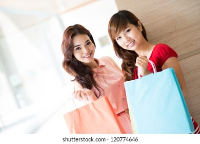 Two girlfriends doing shopping together
