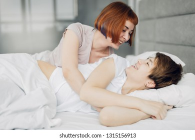 two girlfriends having great time in the bedroom. close up photo.