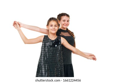 two girlfriends. portrait of girls in the studio. fashion shooting of children