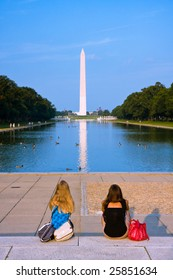 Two girls admiring the Washington monument