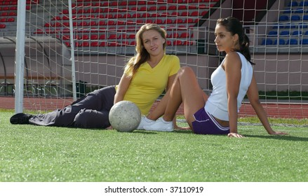 Two girls after training in stadium