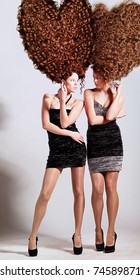 two girls with big curly heart-shaped hairstyle