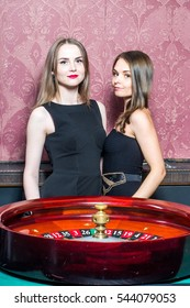 Two girls in casino around roulette