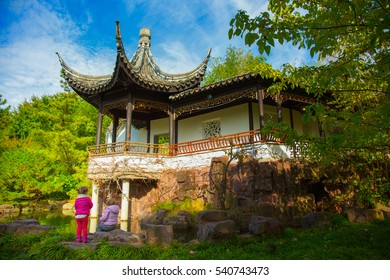 two girls in a Chinese Garden