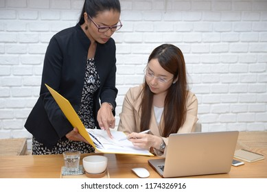 Two girls discussing about their work. They are great co-worker ever in their Company.