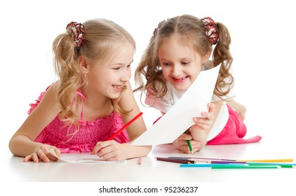 two girls drawing with color pencils together. Focus on the girl on foreground