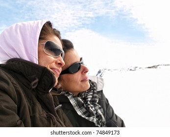 Two girls enjoying in the snow