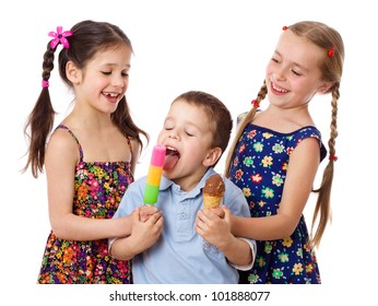 Two girls are feeding a little boy with ice cream, isolated on white