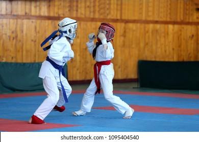 Two girls fight in Jiu Jitsu competitions.