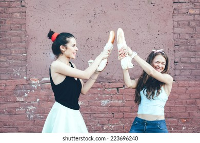Two girls fighting bread. Outdoor lifestyle portrait