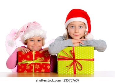 two girls girl with Santa- cap and presents