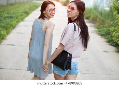 Two girls going to sunset and turn around. Best friends