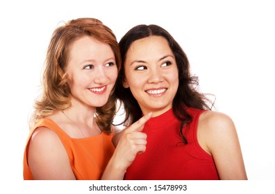 two girls gossip and point at something
