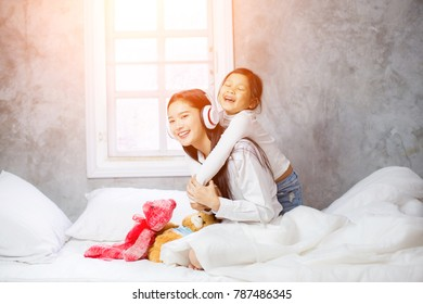 Two girls are happy on the bed.children playing and having fun in the kids room.