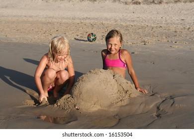 two girls having fun on the beach