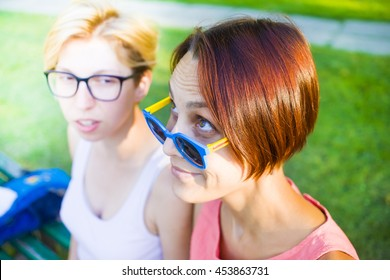 Two girls having fun in Park during holiday.