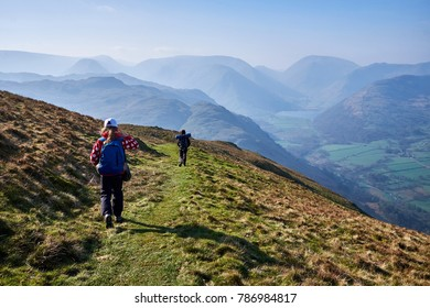 Two girls hike high up on Place Fell in the English Lake District, Cumbria.