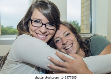 Two girls hug each other