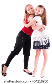 two girls hugging on a white background