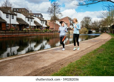 Two girls jogging outdoors in London