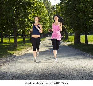Two girls jogging in the park