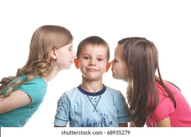 two girls kissing little smiling handsome boy