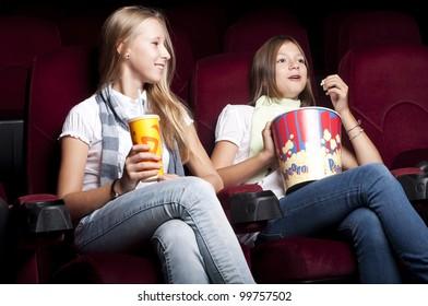 two girls look cinema