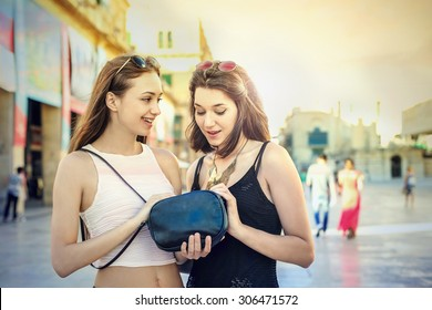 Two girls looking in a bag