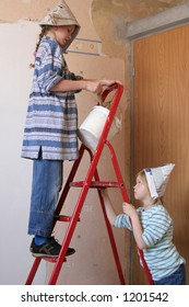 Two girls on a ladder