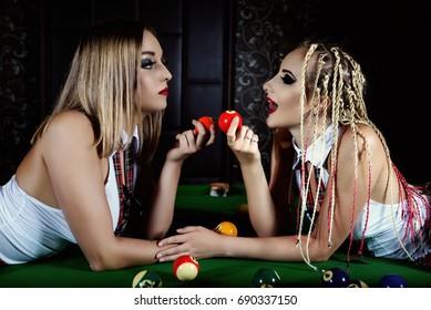 Lesbians on a pool table