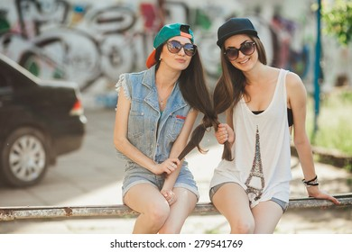 two girls on the street, sisters
