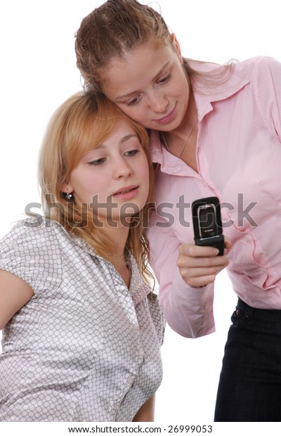 two girls with a phone