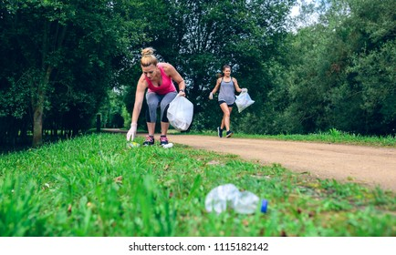 Two girls picking up trash while plogging outdoors